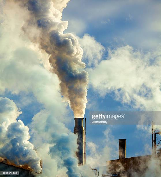 Dirty Smoke Stacks Belch Carbon and Pollution into the Atmosphere