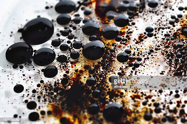 dirty tar balls from enviormental oil spilled in clear water - tar stock pictures, royalty-free photos & images