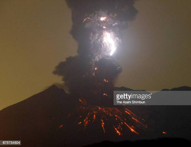 Dirty thunderstorms occurs over Mount Sakurajima as the volcano erupts at 320am on May 2 2017 in Tarumizu Kagoshima Japan Five eruptions are recorded...