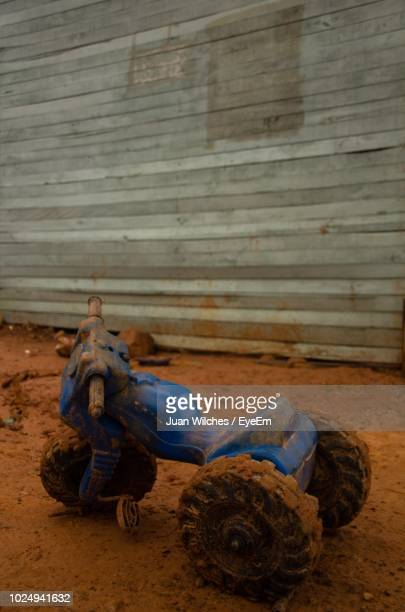 dirty tricycle on mud - tricycle stock pictures, royalty-free photos & images