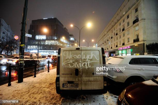 A dirty van with Merry Christmas in Polish written on it is seen in the center of Warsaw Poland on December 20 2018 Poles this year will spend on...