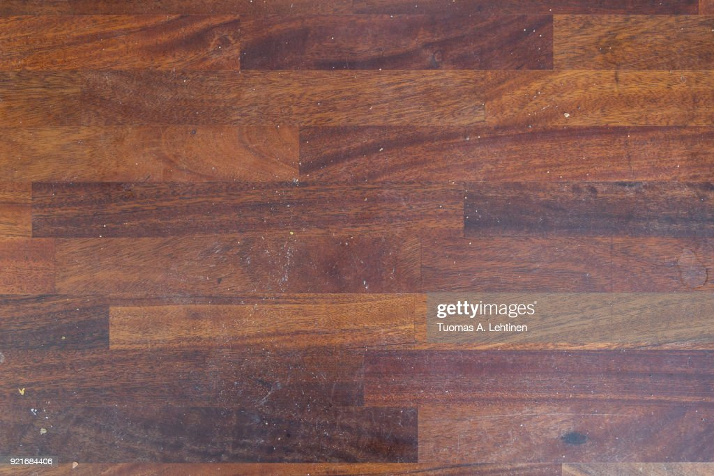 Dirty wooden kitchen counter with stains and breadcrumps viewed from above. : Stock Photo