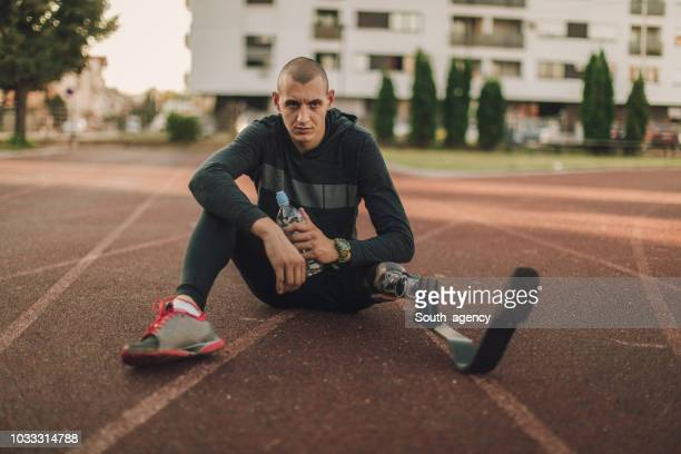 disability athlete taking a brake - adaptive athlete stock pictures, royalty-free photos & images