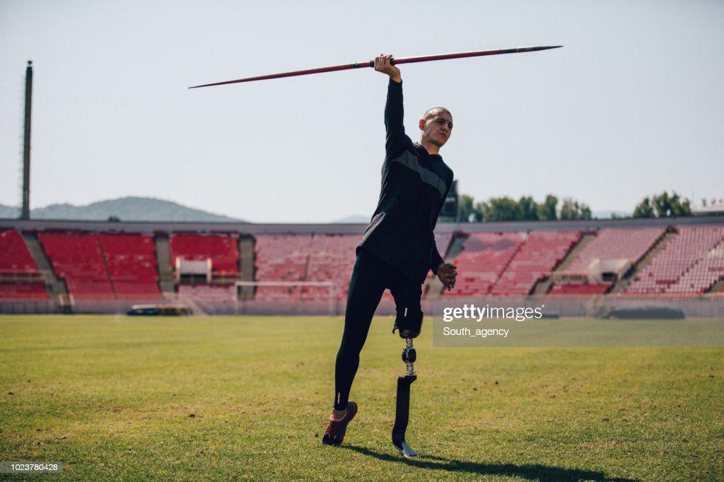 Disability athlete throwing javelin : Stock Photo