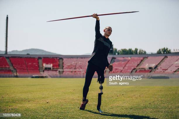 disability athlete throwing javelin - traditional sport stock photos and pictures