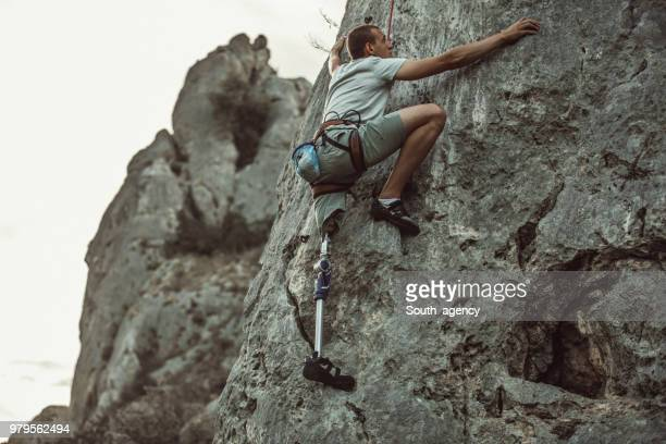 disability guy climber - artificial limb stock photos and pictures