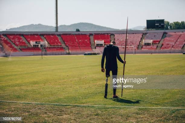disability guy holding javelin - men's field event stock pictures, royalty-free photos & images