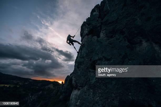 disability man climbing - artificial limb stock photos and pictures