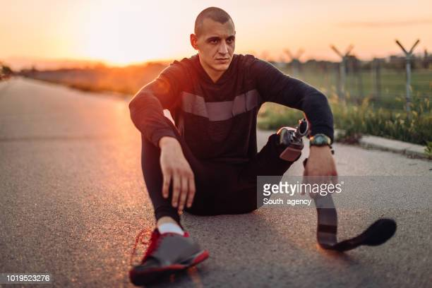 disability man taking a break - men's track stock photos and pictures