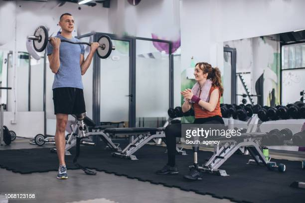 disability man weightlifting - artificial limb stock pictures, royalty-free photos & images