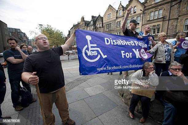 A disability rights activist heckling British Labour Party politician Jim Murphy MP as he addresses supporters at a No Thanks antiScottish...