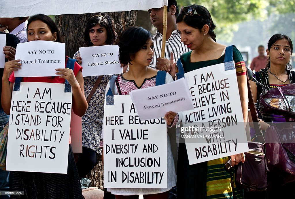 Disability Rights activists hold placards during a protest outside the Indian Health Ministry in New Delhi on October 10, 2012, held to mark World Mental Health Day