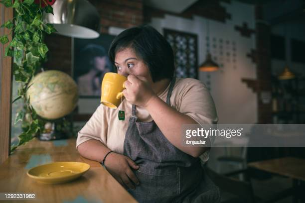 disable girl drink coffee in the cafe and looking away - coffee drink stock pictures, royalty-free photos & images