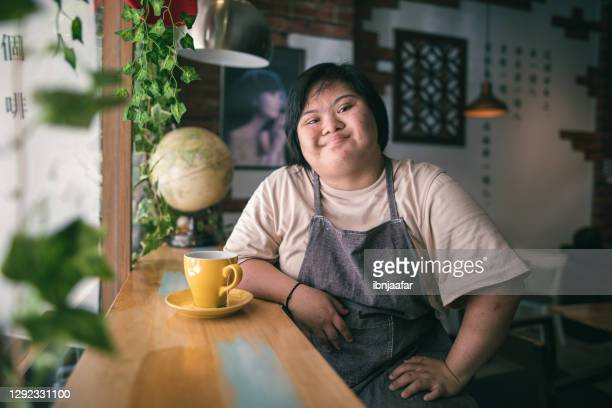 disable girl drink coffee in the cafe and looking to the camera - coffee drink stock pictures, royalty-free photos & images