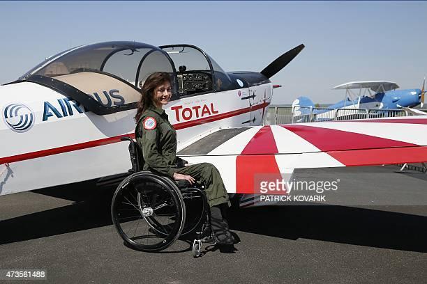 Disabled aerial acrobat Dorine Bourneton poses during an air show at the airfield of SaintCyr l'Ecole on April 19 2015 AFP PHOTO / PATRICK KOVARIK