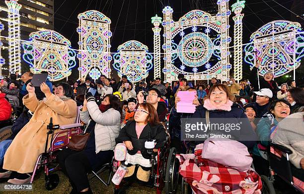 Disabled and handcapped people enjoy the Kobe Luminarie at the Heatful Day ahead of the official opening on November 30 2016 in Kobe Hyogo Japan The...