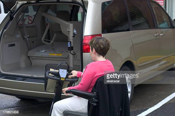 disabled and her minivan - mobility scooter stock photos and pictures