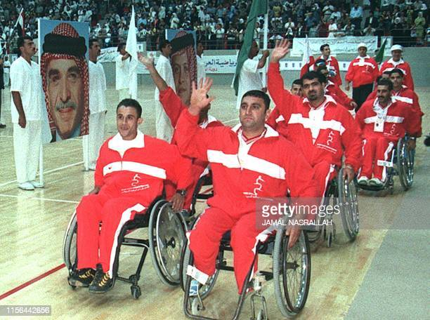 Disabled Arab athletes salute the audience including King Abdullah II and Queen Rania of Jordan at the opening session of the first PanArab Games...