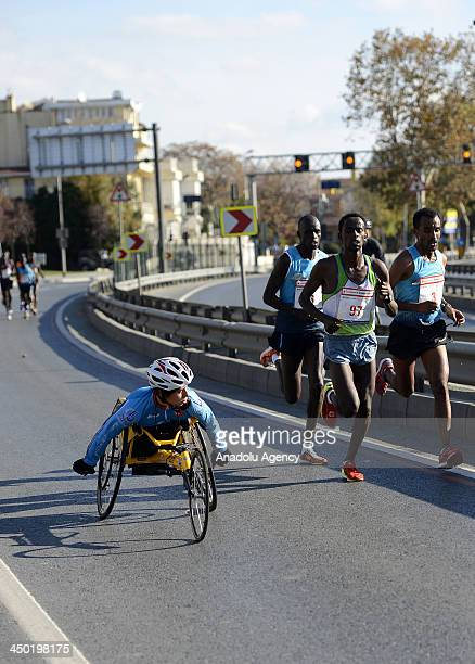 A disabled athlete competes as the other athletes run during The 35th Istanbul Marathon on November 17 2013 in Istanbul Turkey Around 20000 athletes...