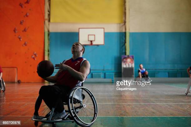 Disabled athlete getting ready to shoot hoop