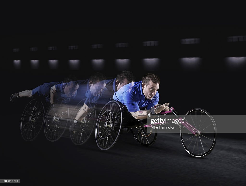 Disabled athlete racing in wheelchair. : Stock Photo