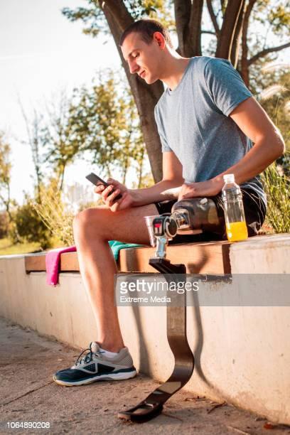 Disabled athlete resting after jogging