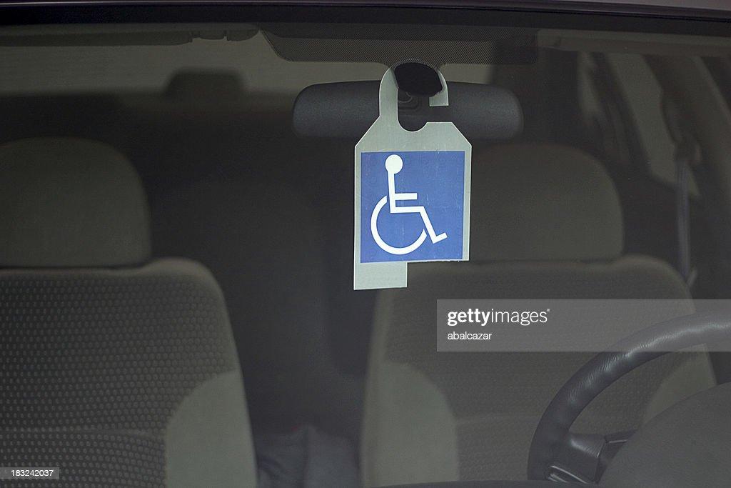 Crachá com deficiência : Foto de stock