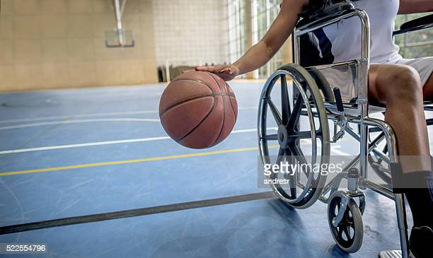 Disabled basketball player bouncing the ball