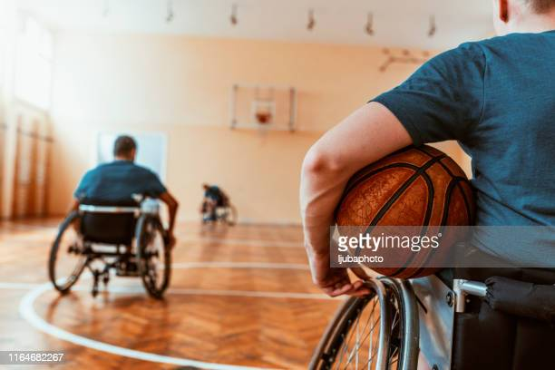 disabled basketball player on wheelchair - basketball player stock pictures, royalty-free photos & images