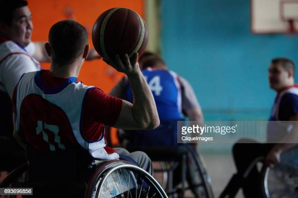 disabled basketball player passing ball - cliqueimages stock pictures, royalty-free photos & images