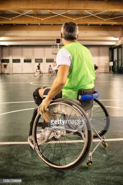 disabled basketball players shaking hands - fair play sport foto e immagini stock