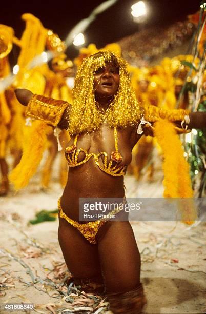 A disabled black woman dancing at the Carnival Samba Schools Parade