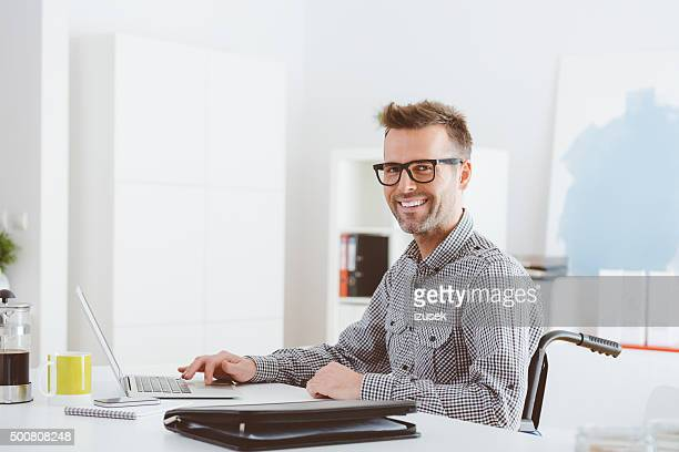 Disabled businessman working in an home office
