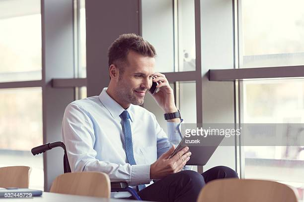 disabled businessman working in an office - differing abilities female business stock pictures, royalty-free photos & images