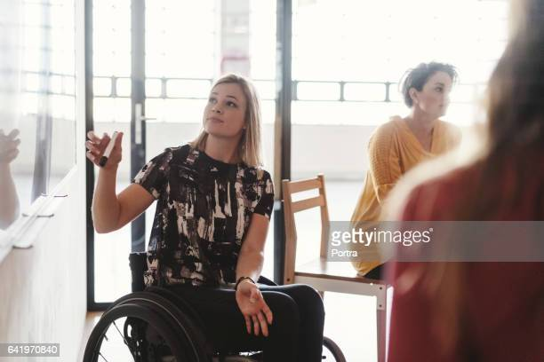 Disabled businesswoman giving presentation
