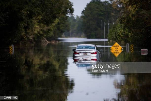 Disabled car is surrounded by floodwaters caused by Hurricane Florence near the Todd Swamp on September 21, 2018 in Longs, South Carolina....