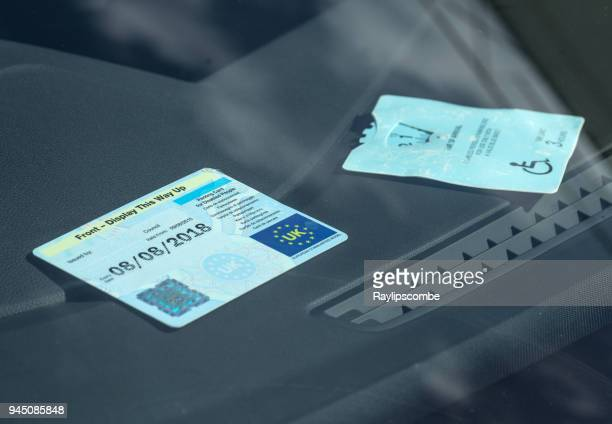 disabled car parking badge being displayed in the front of a car windscreen - disabled sign stock photos and pictures