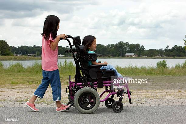 disabled child - black hair stock pictures, royalty-free photos & images