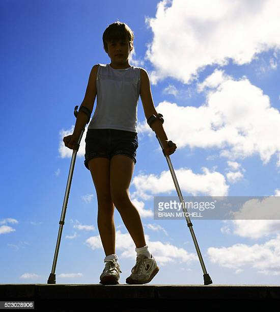 disabled child using crutches - polio stock pictures, royalty-free photos & images
