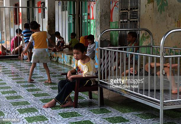 Disabled children are seen inside a staterun orphanage in Ba Vi district on the outskirts of Hanoi on September 16 2014 US parents will be allowed to...
