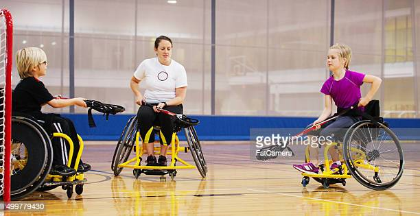 Disabled Children Being Coached at the Gym