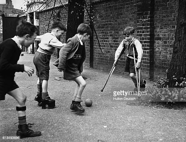 Disabled children play football in the playground of the Franklin Delano Roosevelt School for Physically Handicapped Children