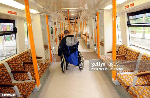 A disabled customer navigates their way through 'worm design' carriage in the first of 54 new trains for Transport for London's Overground network...