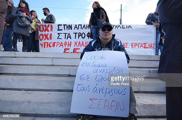 A disabled demonstrator holds a picket that calls Greek government to give more money to unemployment benefitsGreek PAME union organised a...