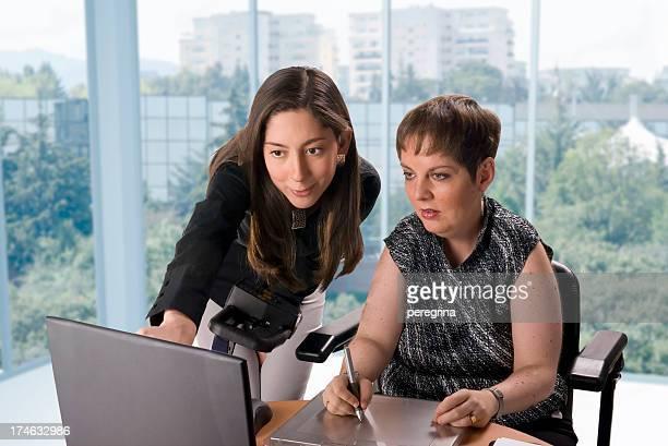Disabled designer and co-worker