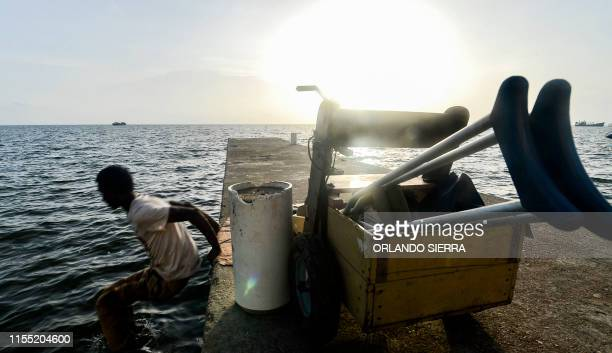 Disabled diver Ernesto McLean jumps from a dock into the water in Puerto Lempira Honduras on July 8 2019 Thousands of fishing divers of the Mosquitia...