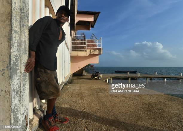 Disabled diver Ernesto McLean leans against a wall at a dock in Puerto Lempira Honduras on July 8 2019 Thousands of fishing divers of the Mosquitia...