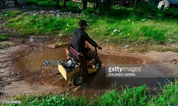 Disabled diver Ernesto McLean rides a makeshift handicapped cart in Prumnitara Puerto Lempira Honduras on July 8 2019 Thousands of fishing divers of...