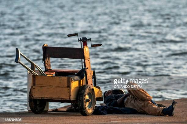 Disabled diver Ernesto McLean takes a nap on a dock in Puerto Lempira Honduras on July 8 2019 Thousands of fishing divers of the Mosquitia region...