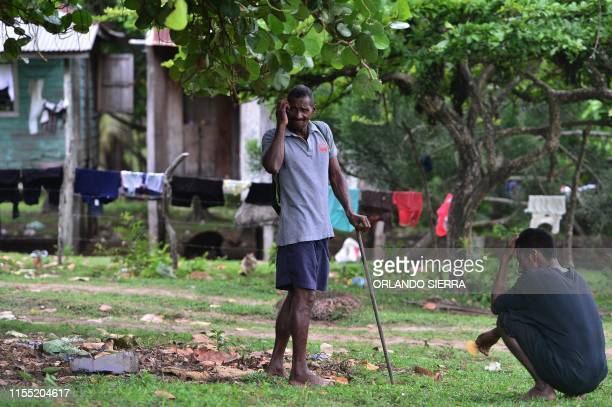 Disabled divers Jaime Lemus Matute and Willy Pamista chat in Prumnitara Puerto Lempira Honduras on July 8 2019 Thousands of fishing divers of the...